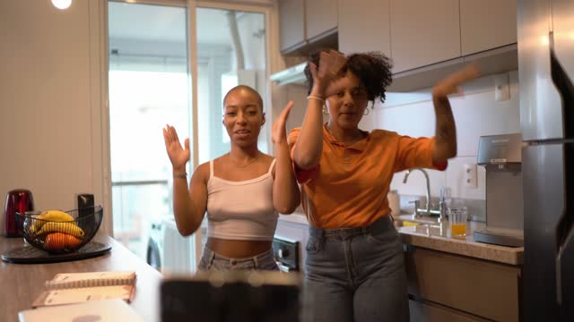 happy friends at home dancing and filming it - kitchen stock videos & royalty-free footage