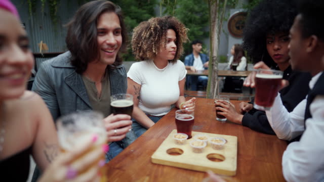 happy friends having a great time at the pub - outdoors stock videos & royalty-free footage