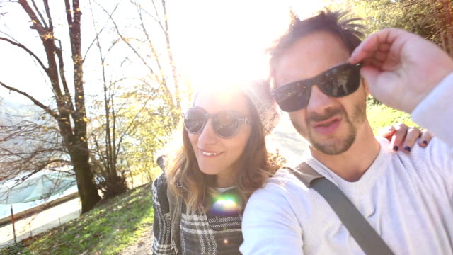 Happy funny young hipster couple making faces