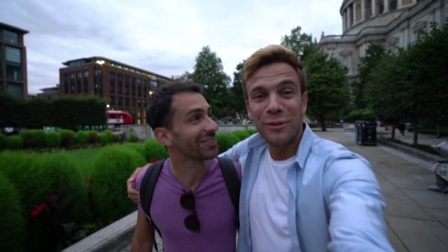 happy gay couple on a video call showing all the tourism around the city - casual clothing stock videos & royalty-free footage