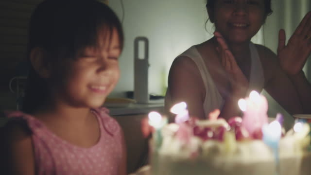 happy girl celebrating her birthday party at home - birthday candle stock videos & royalty-free footage