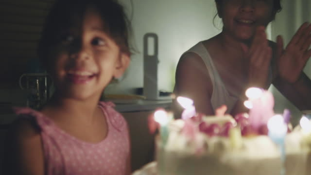 happy girl celebrating her birthday party at home - compleanno video stock e b–roll