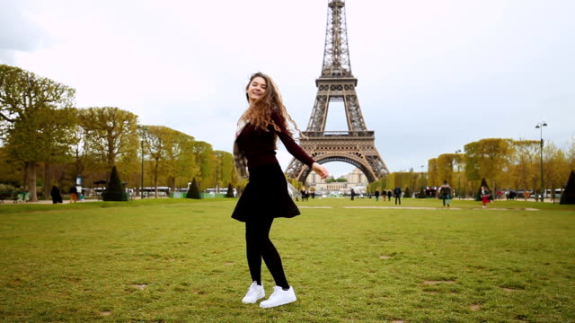 happy girl enjoying paris - eiffel tower paris stock videos & royalty-free footage