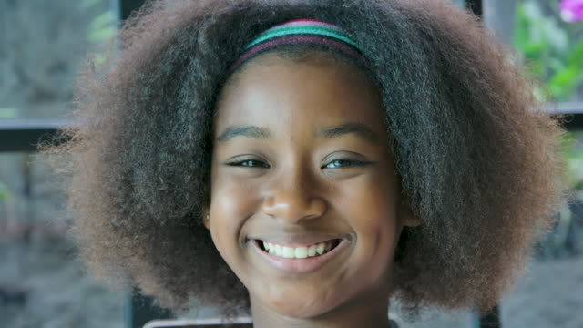 happy girl smiling on camera, teenager rights. - afro stock videos & royalty-free footage
