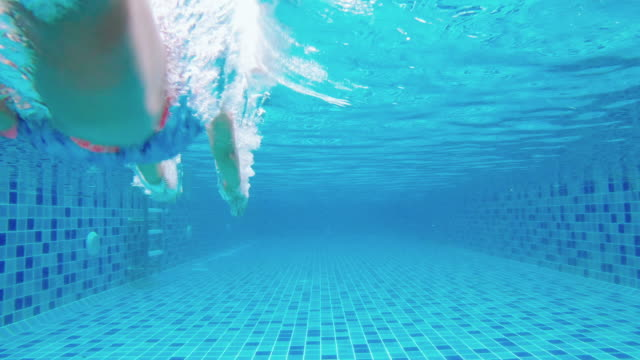 happy girl swimming underwater - lido stock videos & royalty-free footage