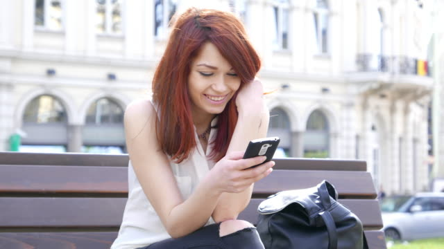 Happy girl text messaging