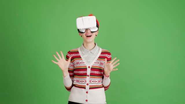 happy girl with virtual reality glasses on a green background - blouse stock videos & royalty-free footage