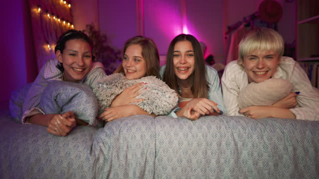 happy girlfriends at sleepover watching a movie on a tv - slumber party stock videos & royalty-free footage