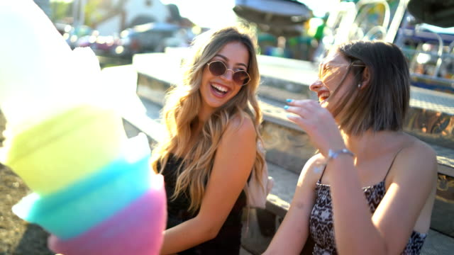 happy girlfriends at the amusement park - adult stock videos & royalty-free footage