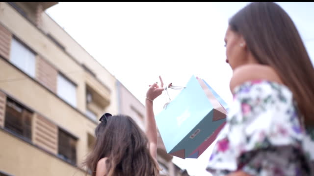 happy girlfriends enjoy shopping - shopping bag stock videos & royalty-free footage