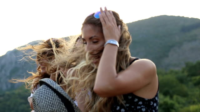 happy girlfriends on viewpoint at sunset - girlfriend stock videos & royalty-free footage