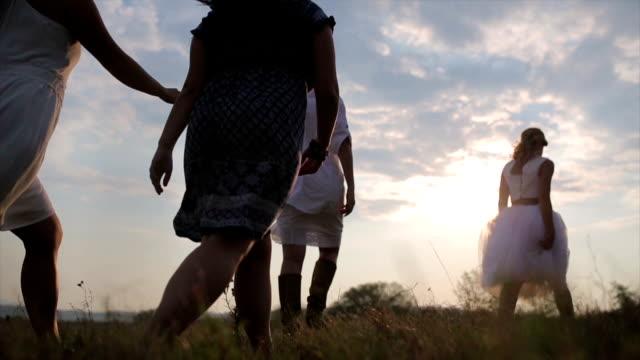 happy girls having good fun time outdoors. - symbol stock videos & royalty-free footage