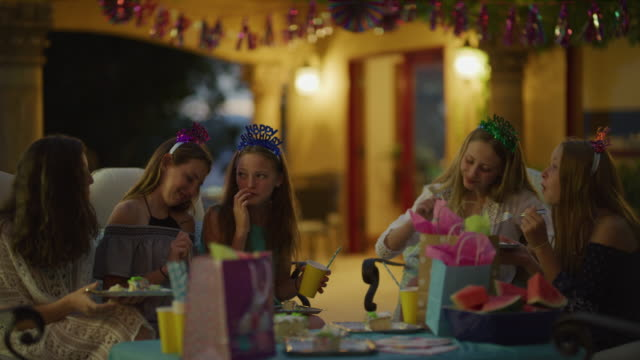 happy girls talking and eating birthday cake at party / cedar hills, utah, united states - pre adolescent child stock videos & royalty-free footage