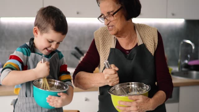 happy grandmother and grandson preparing cookies - nutrition label stock videos and b-roll footage