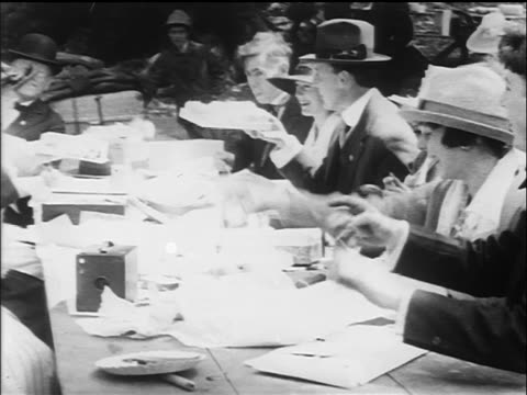 b/w 1917 happy group at picnic table eating / bookbinders union picnic, san francisco / newsreel - newsreel stock videos and b-roll footage