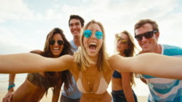Happy group of friends having fun taking selfie