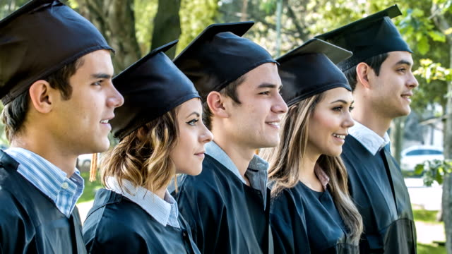 happy group of graduation students - group of objects stock videos & royalty-free footage