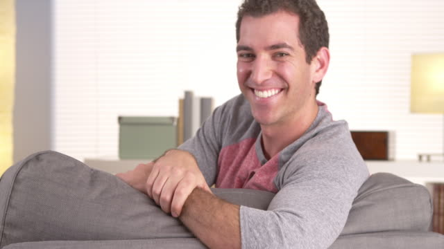 Happy guy lying on couch