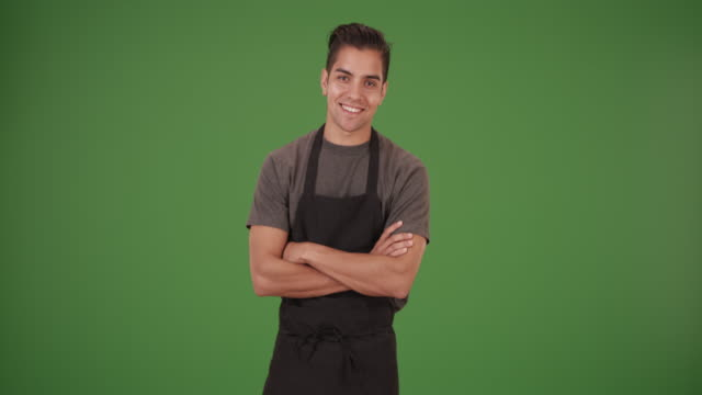 happy handsome young latino waiter on green screen - gastwirt stock-videos und b-roll-filmmaterial