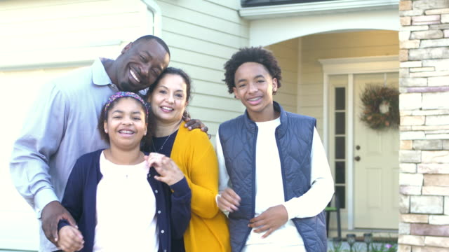 happy interracial family in front of home - cardigan sweater stock videos & royalty-free footage