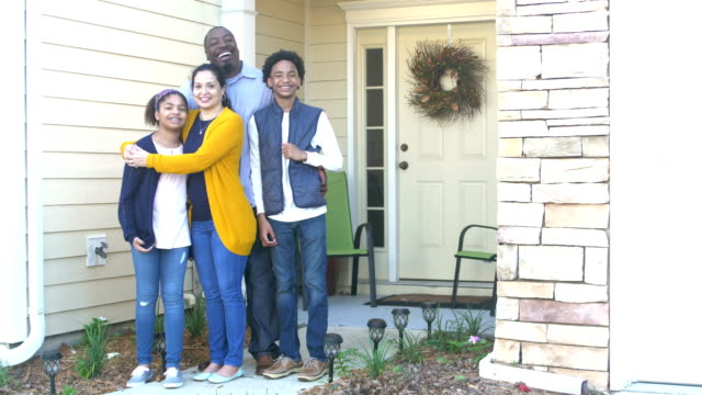 happy interracial family in front of home - 14 15 years stock videos & royalty-free footage