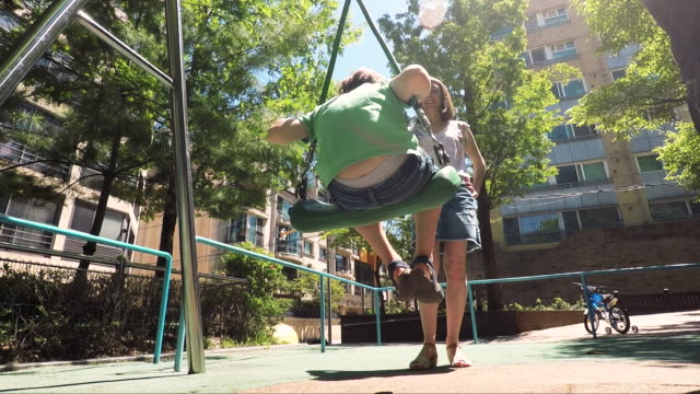 happy kids playing outdoor at the park - swing play equipment stock videos and b-roll footage