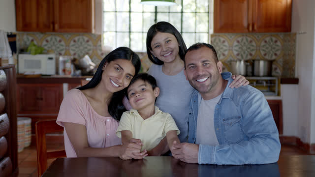 happy latin american family at their rural house all facing the camera smiling - colombia stock videos & royalty-free footage