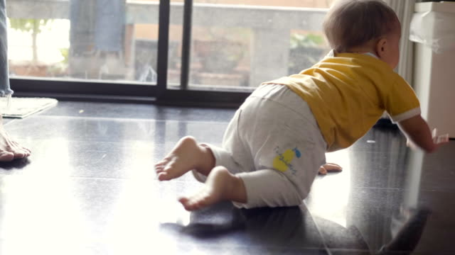 happy little baby crawling in living room at home - crawling stock videos & royalty-free footage