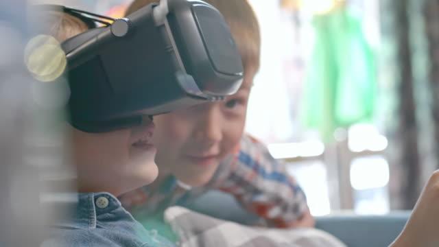 Happy little boy using VR glasses