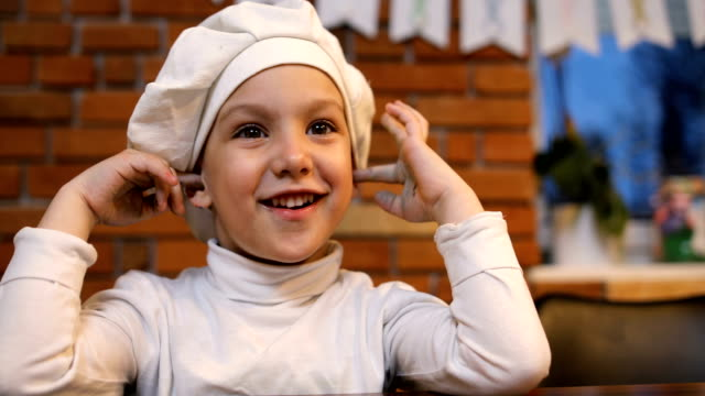 happy little boy with chef's hat in the kitchen - hat stock videos & royalty-free footage