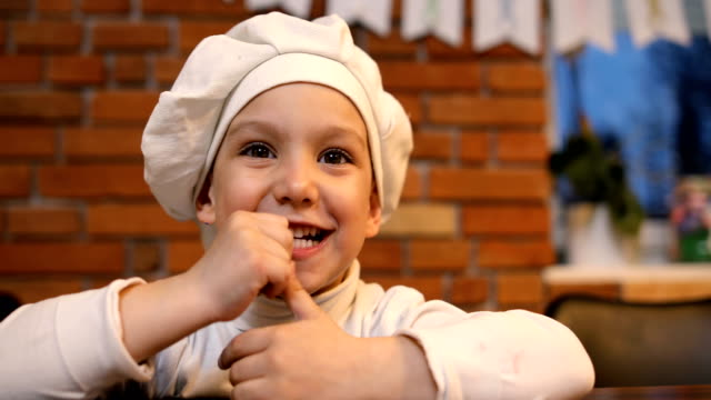 happy little boy with chef's hat in the kitchen - cap stock videos & royalty-free footage