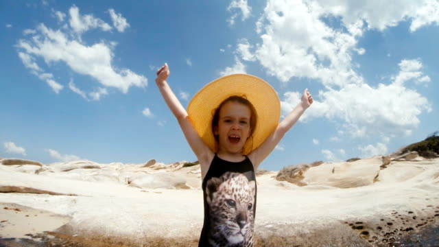 Happy Little Girl at the Beach Gesturing