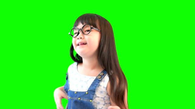 happy little girl dancing on green screen - one girl only stock videos and b-roll footage
