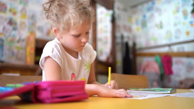 happy little girl doing homework - pencil drawing stock videos & royalty-free footage