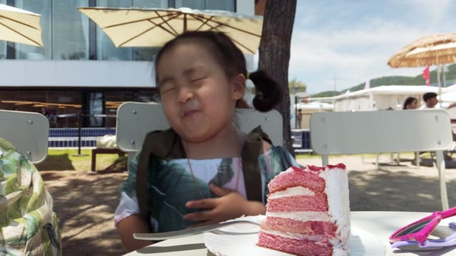 happy little girl eating a cake - children only stock videos & royalty-free footage