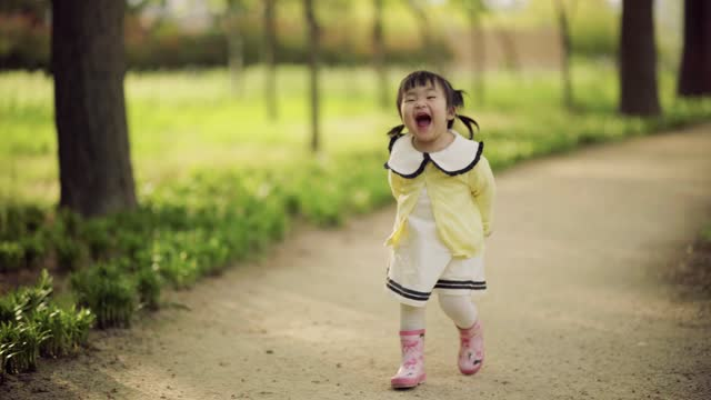 happy little girl having fun at park walkway - children only stock videos & royalty-free footage
