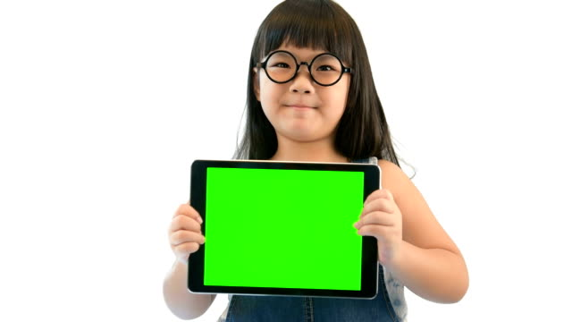 Happy little girl holding green screen tablet PC on white screen