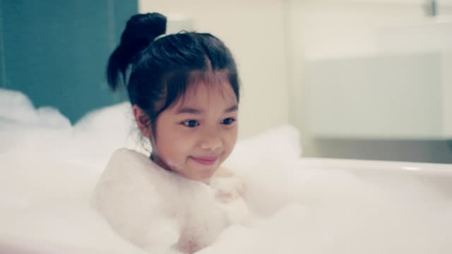happy little girl in the tub - bubble bath stock videos & royalty-free footage