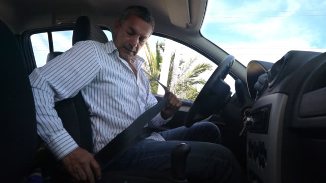 happy man buckling his seat belt and starting the car - seat belt stock videos & royalty-free footage