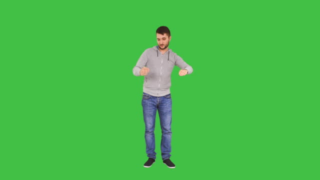 happy man dances like he is a robot - chroma key stock videos & royalty-free footage