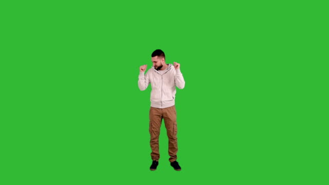 Happy Man dancing on green screen background