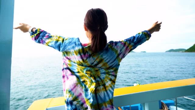 Happy man enjoying view on the boat.