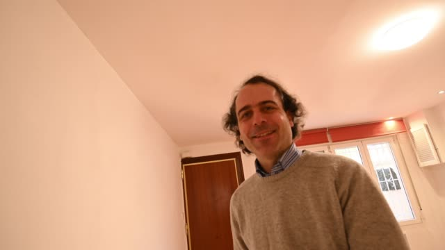 happy man showing the living room of his house and go around enjoying. selfie point of view - going round in circles stock videos and b-roll footage