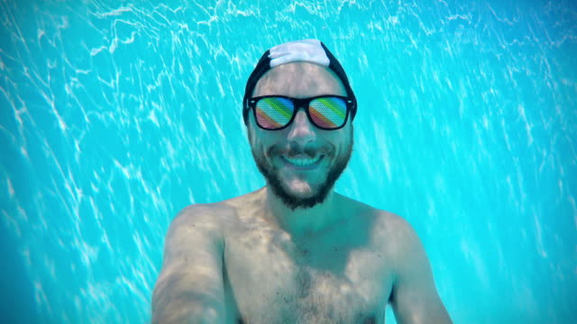 happy man underwater - sleep apnea stock videos and b-roll footage