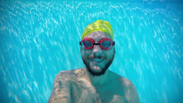 Happy man underwater