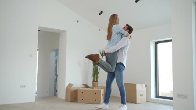 happy married couple celebrating their first house purchasing - nuovo video stock e b–roll