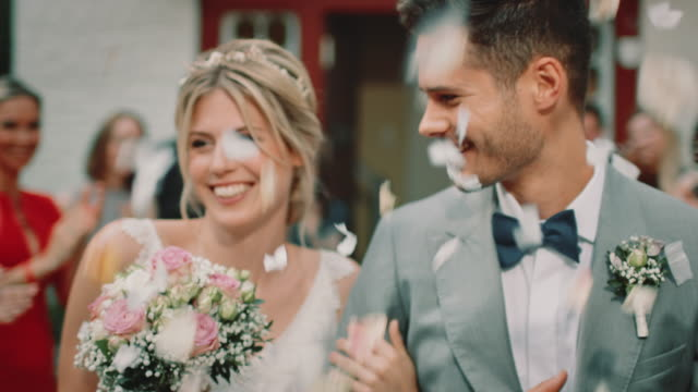 happy married couple kissing while leaving church - married stock videos & royalty-free footage