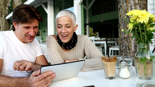 happy mature couple having coffee together at a cafe