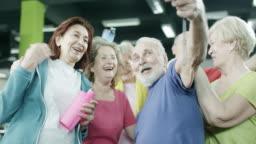 Happy mature people taking a selfie
