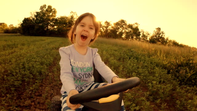 happy memories of her young days- a child of tree drive go-chart, off-road - go cart stock videos & royalty-free footage